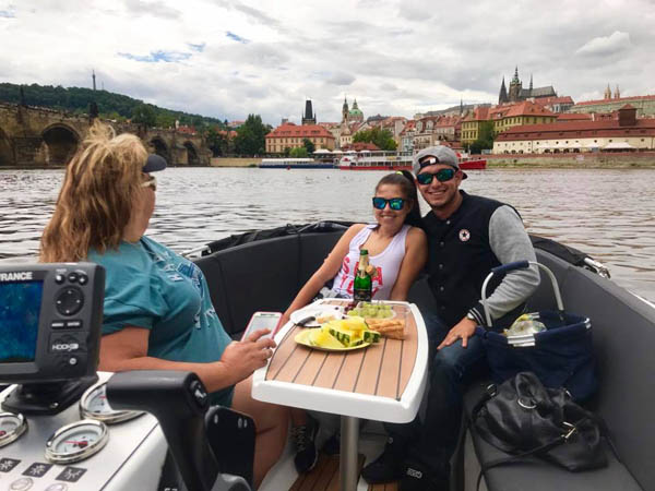 cool guests on their fun boat cruise in Prague